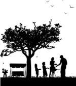rodinné grilování a piknik v zahradě s houpačkou