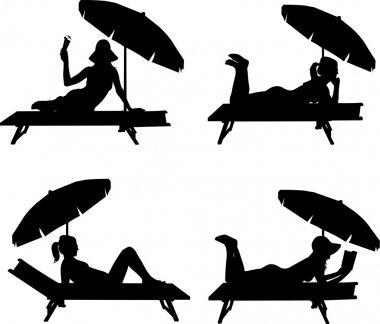Silhouette of girl sunbathing on the beach