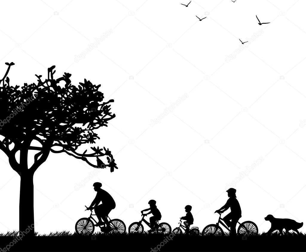 Family bike ride in park in spring or summer silhouette,