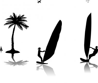 Silhouettes of woman and man windsurfers at the sunset near the palm tree