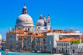 Photo Basilica Santa Maria della Salute with Canal Grande in Venice, Italy