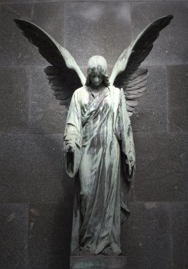 Sculpture of an angel with dark background
