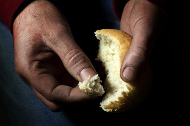 Poverty, hands with bread