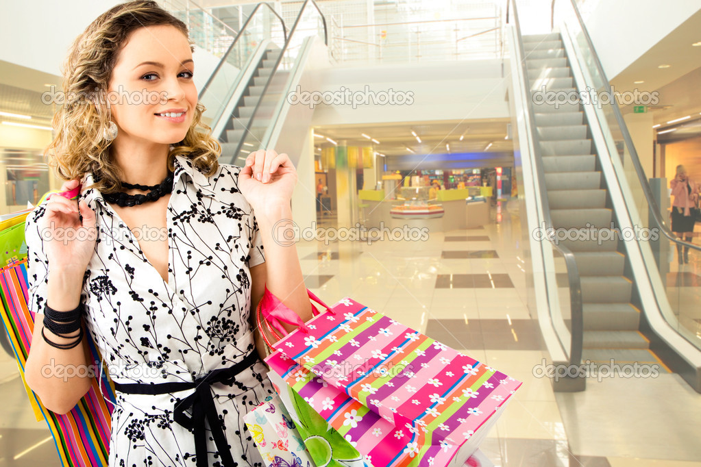 https://static9.depositphotos.com/1594308/1110/i/950/depositphotos_11108182-stock-photo-woman-in-the-shopping-mall.jpg