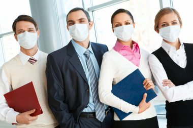 Portrait of business team in protective masks looking at camera stock vector