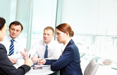 Image of confident colleagues communicating in office stock vector
