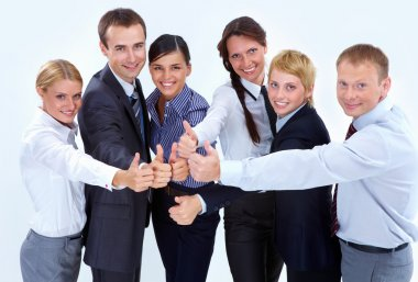 Portrait of friendly business team showing thumbs up and looking at camera stock vector