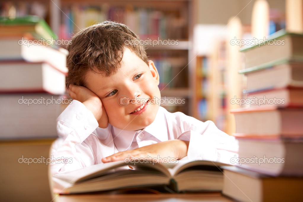 Portrait of smiling schoolboy sitting at the table with books on it stock vector
