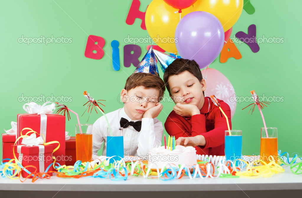 Portrait Of Two Boys Boring During Birthday Party Photo By Pressmaster