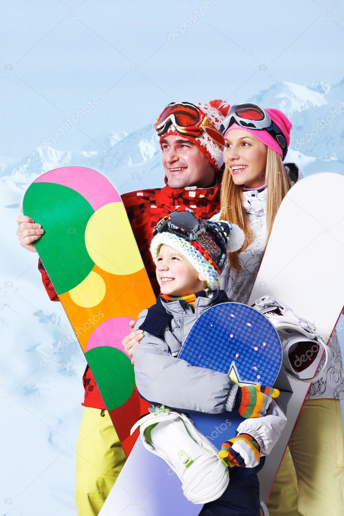 Family of snowboarders