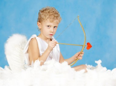Portrait of little male cupid with bow stock vector