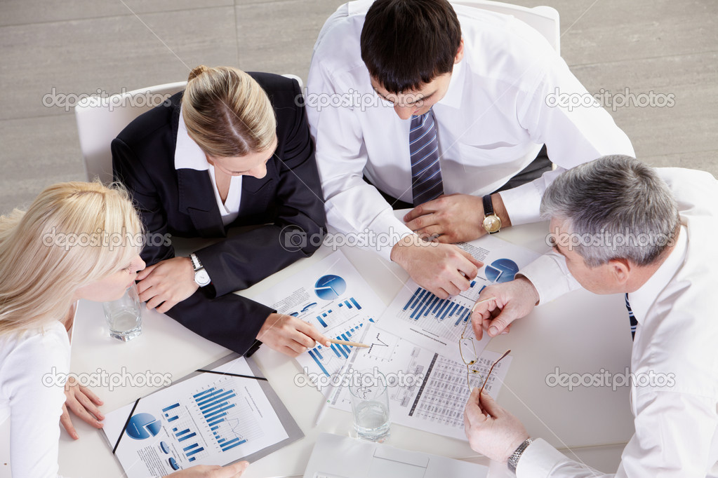 Above view of business team working with graphics stock vector