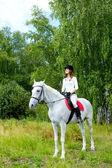 Fotografie Frau auf Pferd
