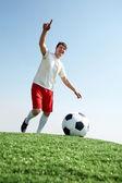 Fotografie fotbalista během hry
