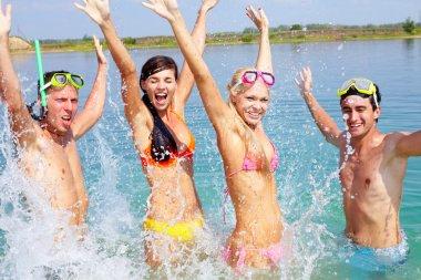 Portrait of four friends splashing in water stock vector