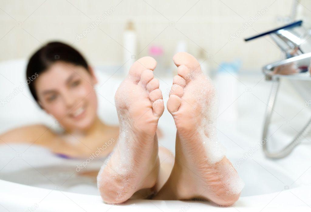 Stock image of image of soles of woman having pleasant bath with foam - Female Feet Stock Photo 169 Pressmaster 11691039