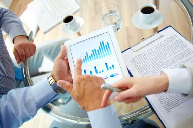 Business work-group analyzing financial data to develop new strategy stock vector