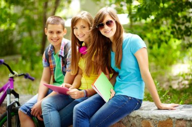 Three friends enjoying their free time after school classes stock vector