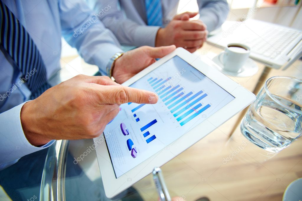 business, graphs and charts on touchpad