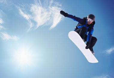 Snowboarder jumping against blue sky stock vector