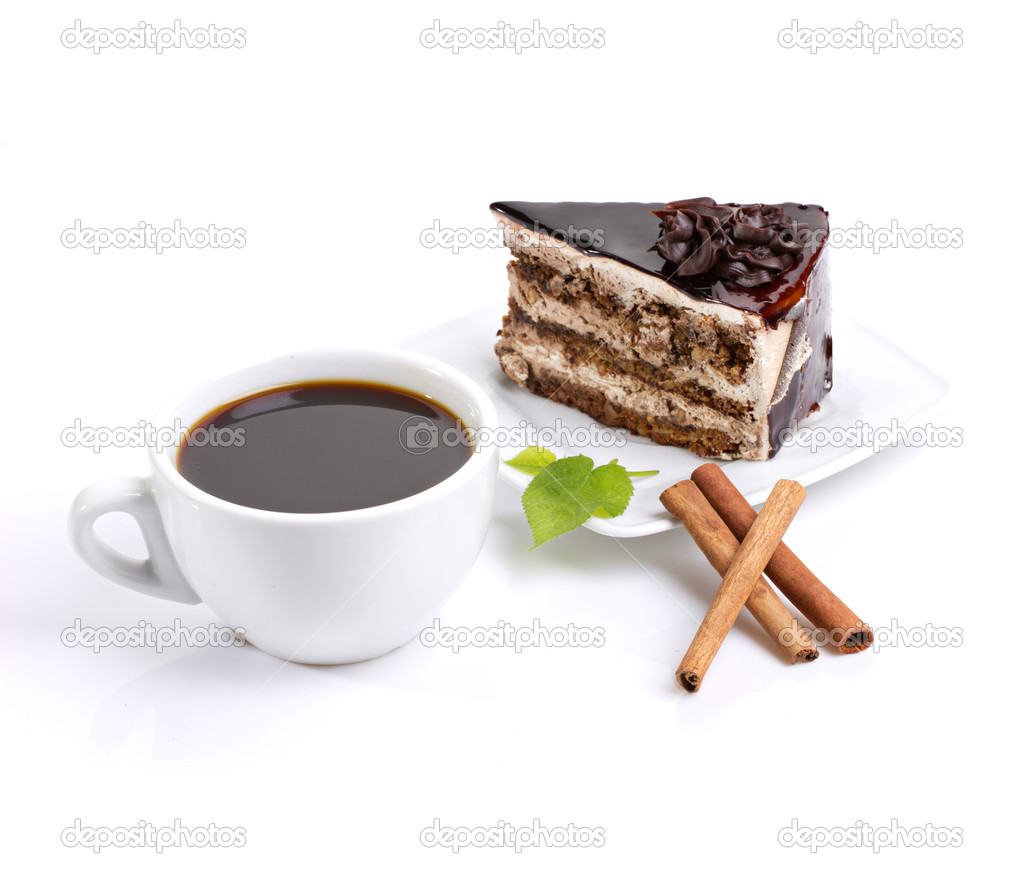 Still-life composed of chocolate cake, coffee and green leafage