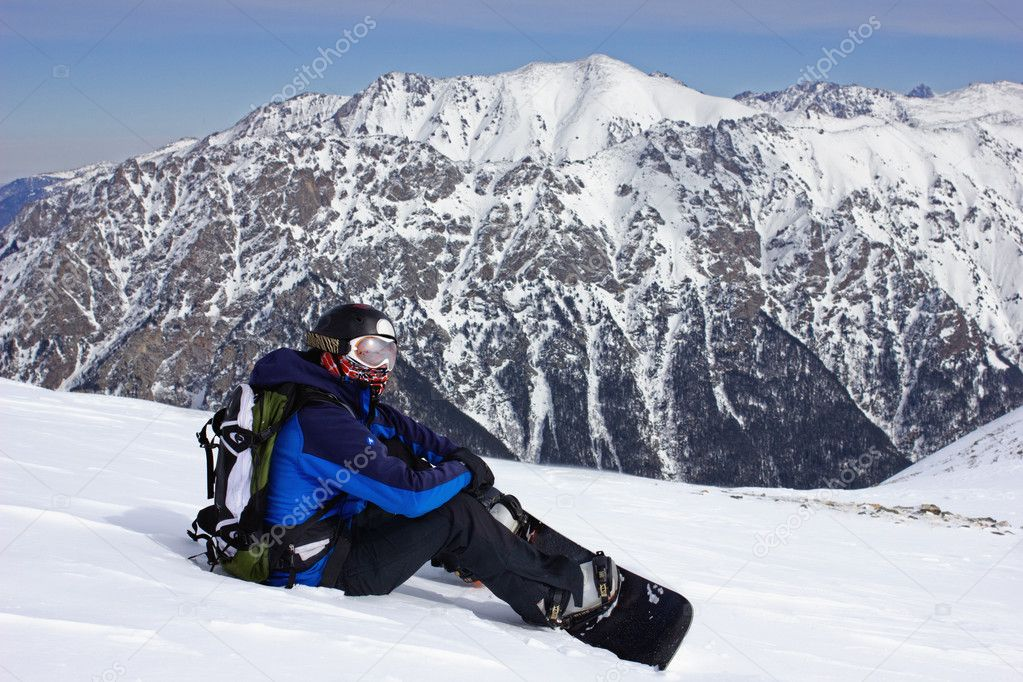 Snowboarder relaxing
