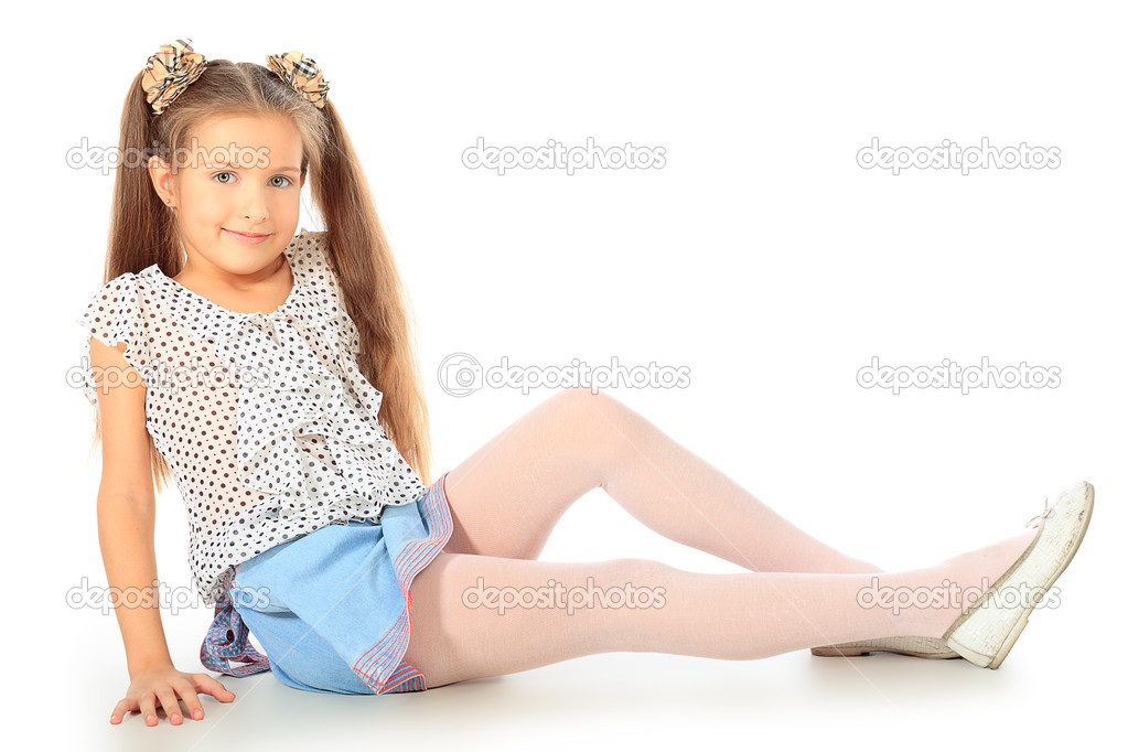 Portrait of a cute 7 years old girl. Isolated over white background.