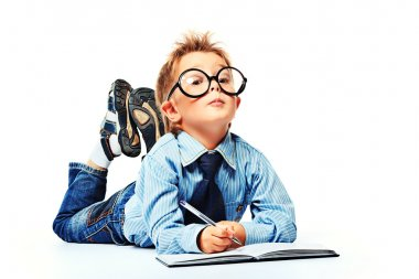 Boy in spectacles and suit lying on a floor