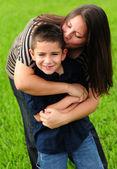Fotografie Mommy kissing Sohn