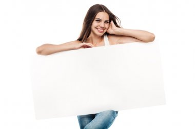 Portrait of a beautiful young woman with blank billboard