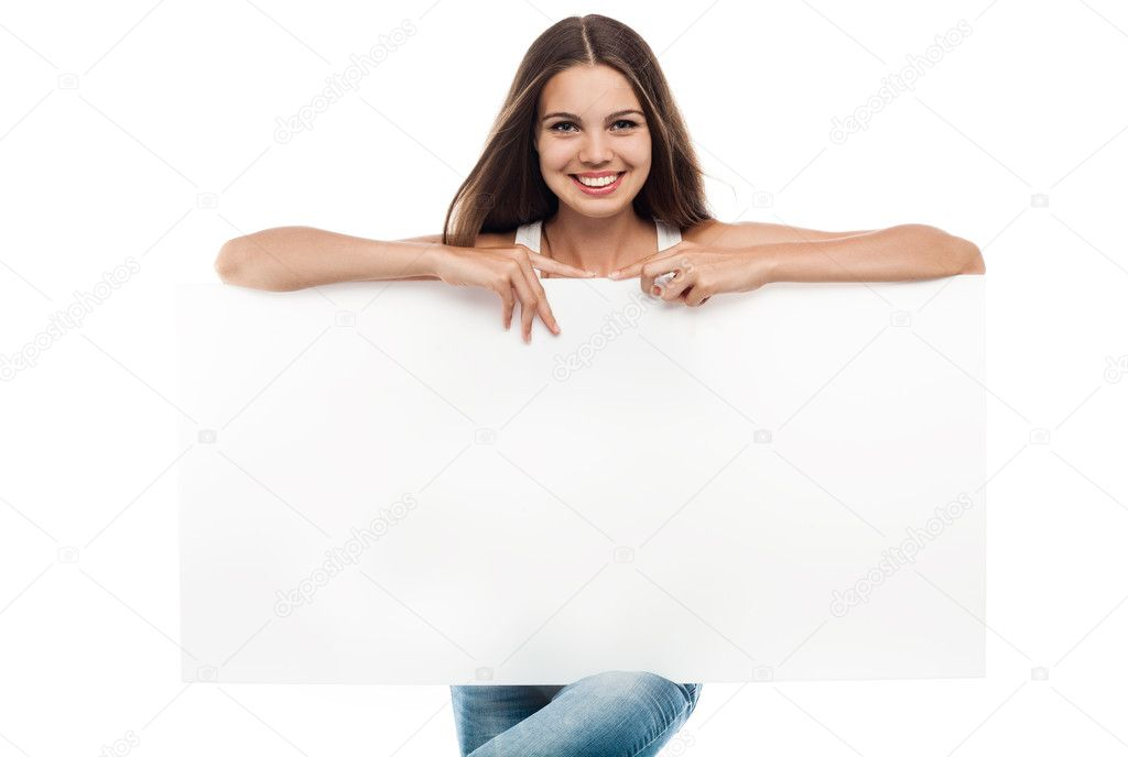 Beautiful woman holding a blank billboard