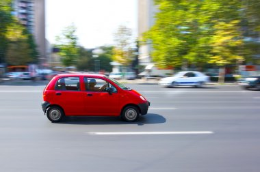 Small car running on the street