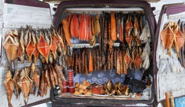 Smocked fish for sale from back of a van. Smolensk highway. Russ