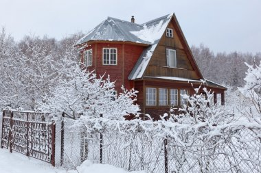 House in countryside (dacha) after heavy snowfall. Moscow region. Russia.