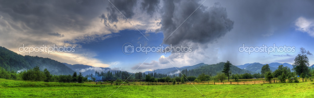 Dark storm clouds over mountains