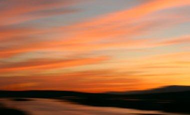 Beautiful sunset blur over water. stock vector