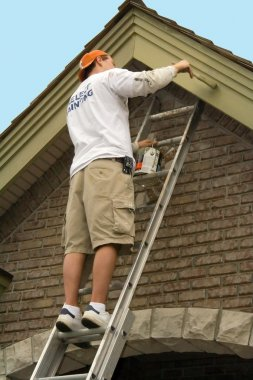 Painter painting exterior trim