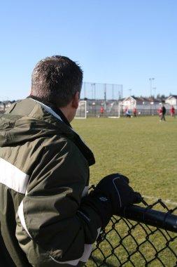 Spectator watching soccer game