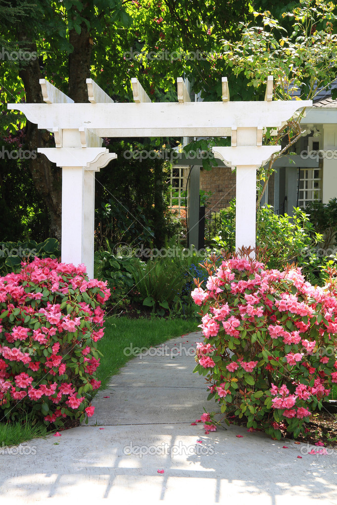 Garden arbor and pink flowers.