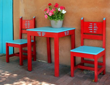 Old vintage red wooden chairs and table