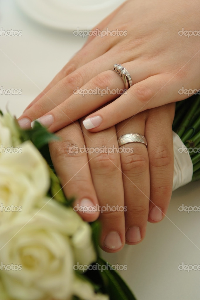 Bride Groom wearing wedding rings Stock Photo nickvango 11244677