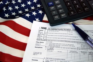 Income tax form on flag