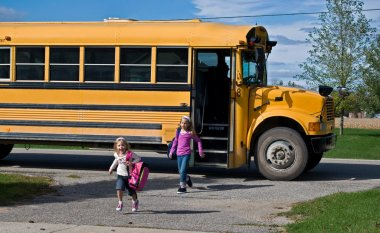 Kids getting off school bus
