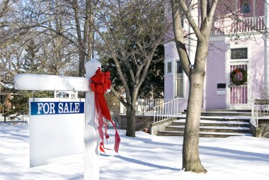 Christmas bow on for sale sign