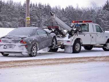 Tow truck towing a wrecked car