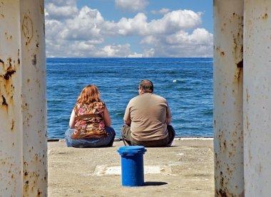 Overweight couple on pier