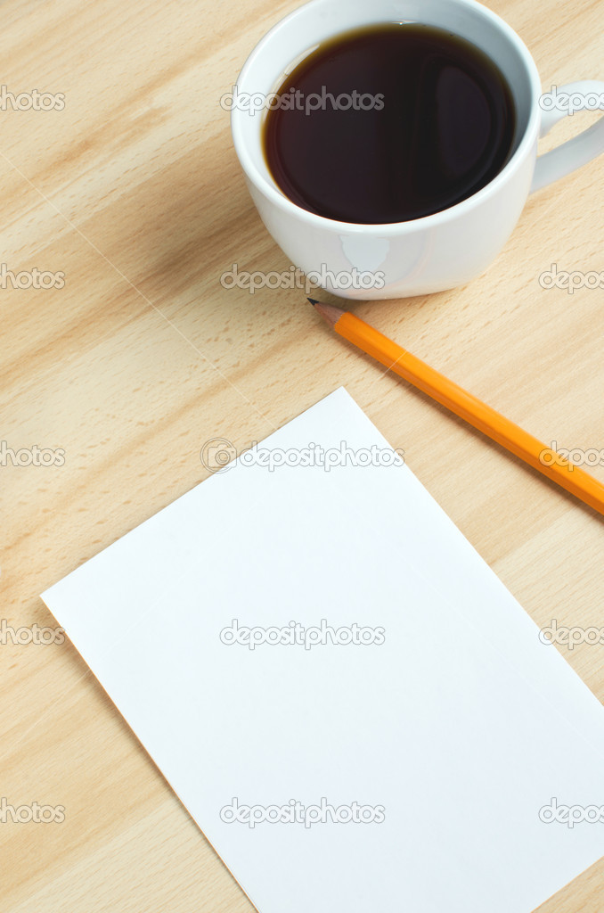 Pen, blank paper on board and cup of coffe