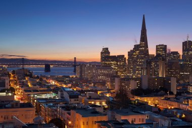 Image of San Francisco skyline with Bay Bridge at twilight. stock vector