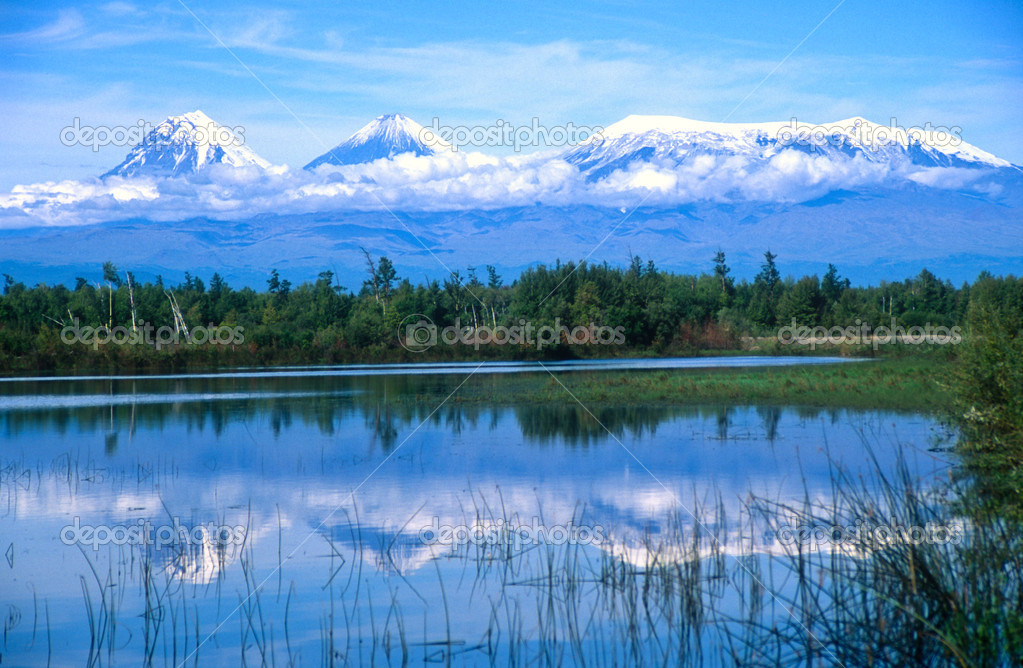 Kamchatkan volcanoes mirrored in a lake