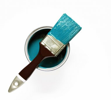 Turquise painted brush on a paint bucket